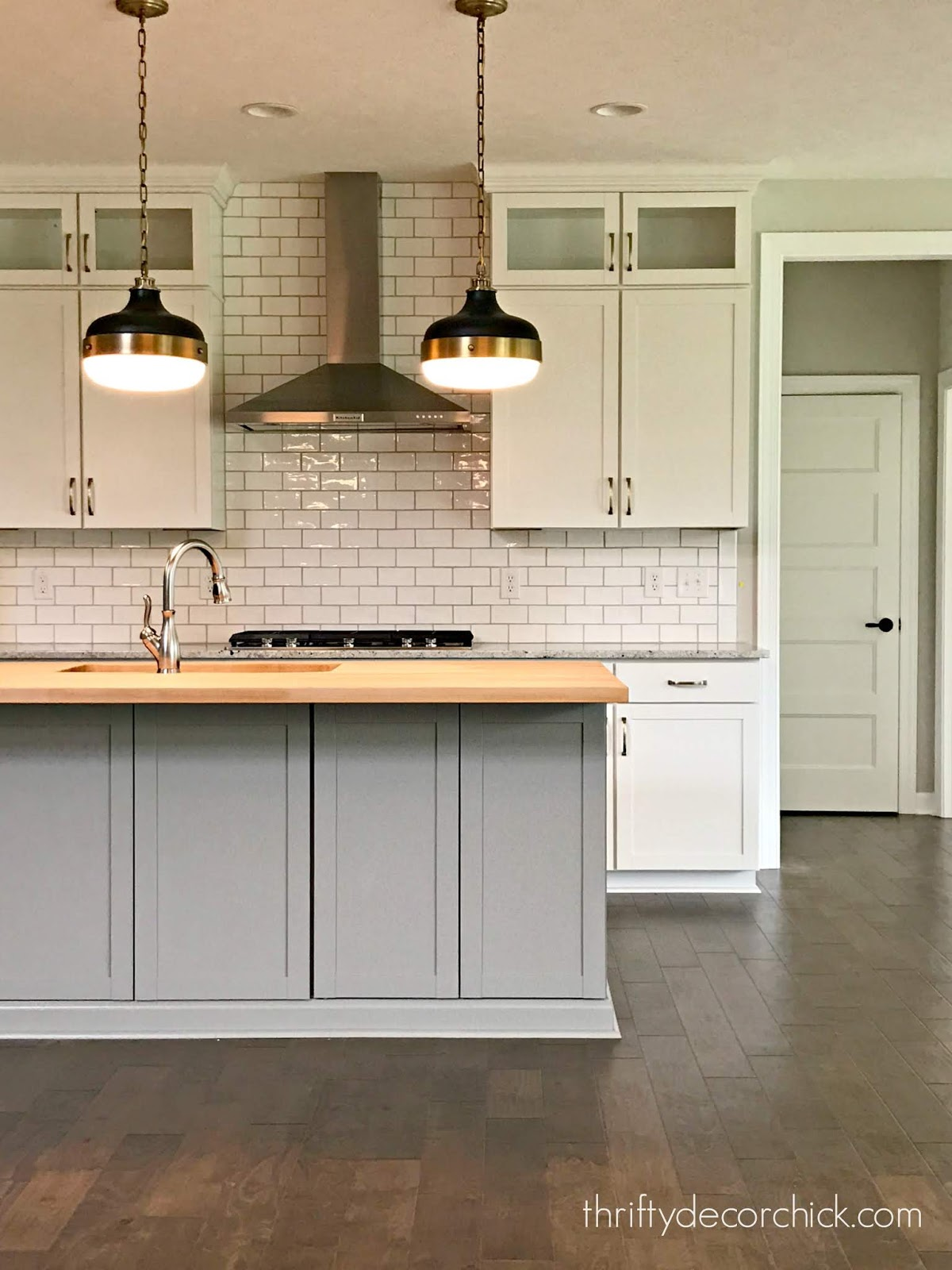 gray and white kitchen with white subway tile