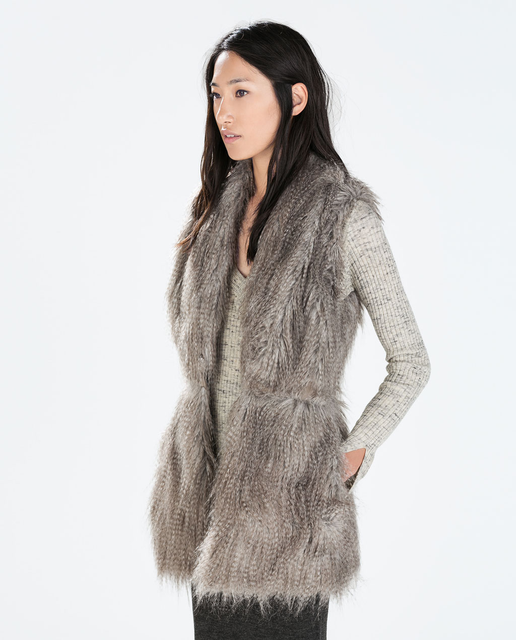 This is a brand new Zara creamy beige faux fur vest that was only worn once. It is super soft and warm and super cute on for a casual day or a night out. It is a size M but does not feel big.