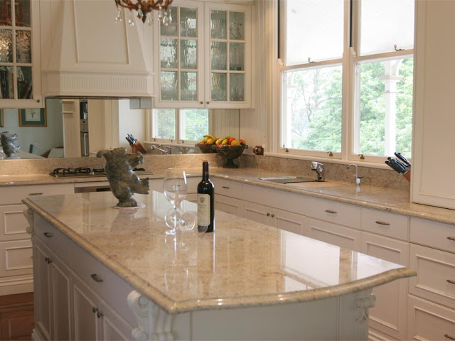 fantasy brown granite with white cabinets