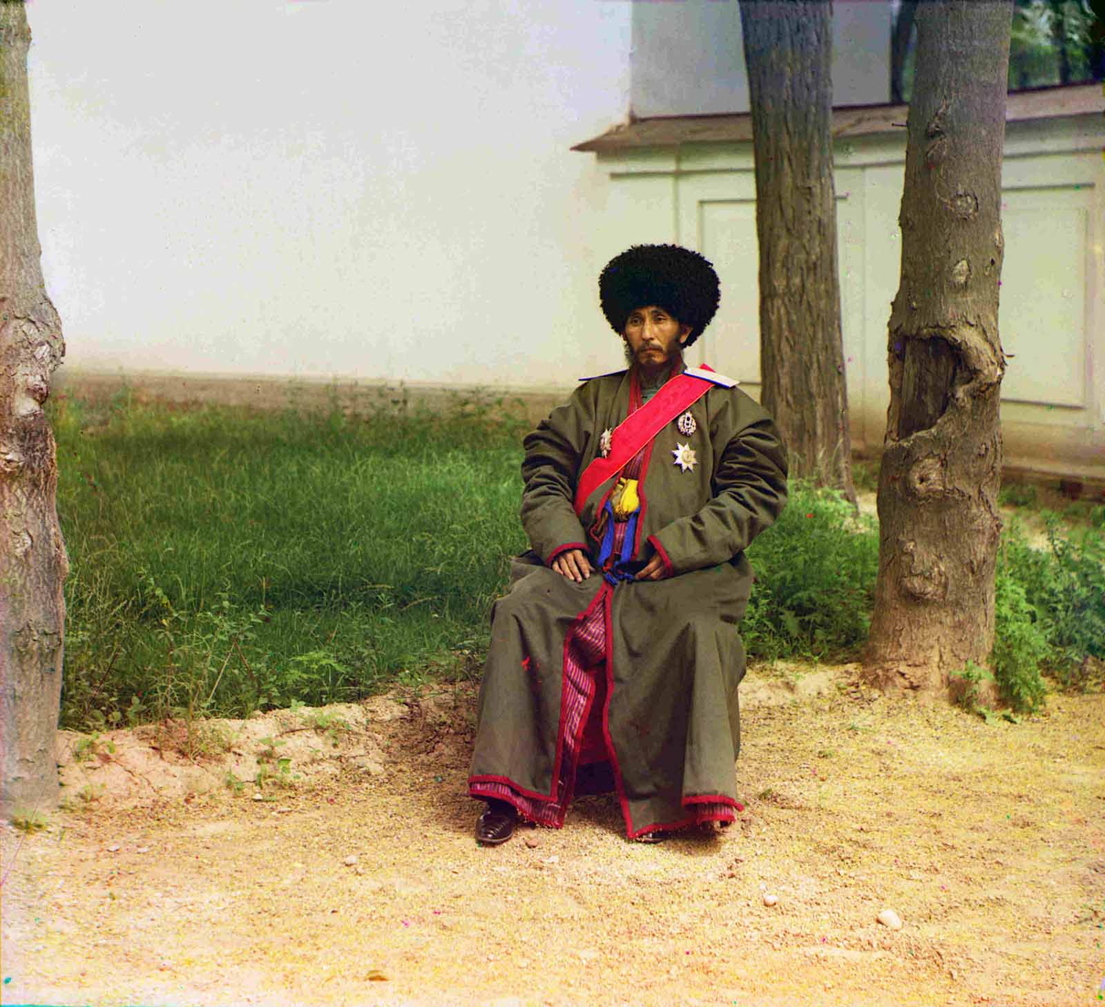 Isfandiyar Jurji Bahadur, Khan of the Russian protectorate of Khorezm (Khiva, now a part of modern Uzbekistan), full-length portrait, seated outdoors, ca. 1910.