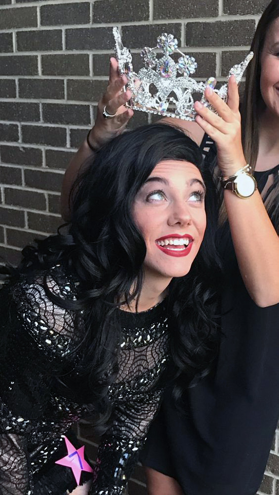 Crowning the queen in a womanless beauty pageant.