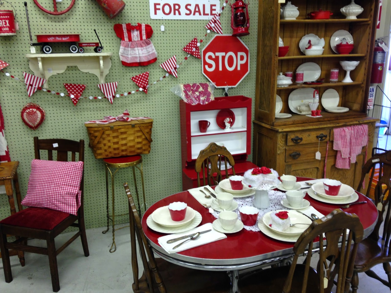 Pollyanna Reinvents Red And White Booth Display For
