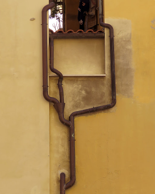 An elaborate drainpipe, via Strozzi, Livorno