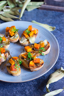 Crusty bread topped with roasted butternut squash and artichokes