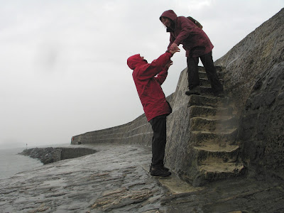 Re-enacting Louisa's famous jump in Persuasion    in the pouring rain on the Cobb at Lyme Regis