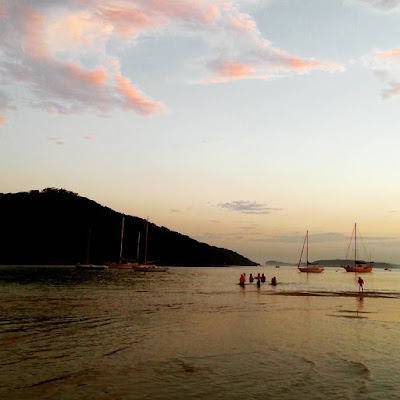 View across an inlet at sunset.