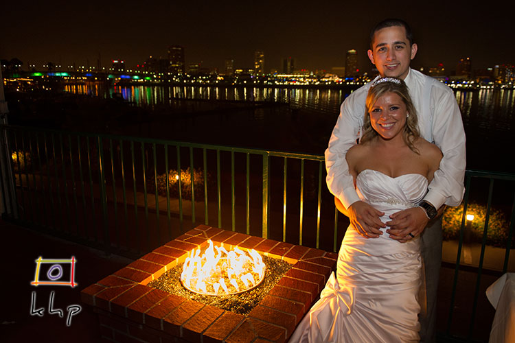 The Reef and the lovely view of the Long Beach Skyline provide a gorgeous backdrop for the newly wed couple's night portrait.