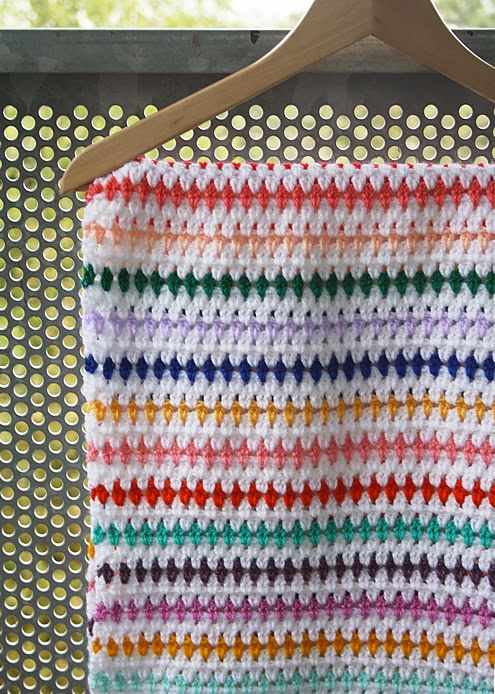 Striped crochet blanket rainbow colours