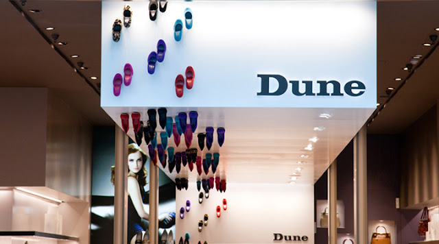 Dune Catwalk shoe store extends the walking space to the ceiling.
