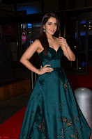 Raashi Khanna in Dark Green Sleeveless Strapless Deep neck Gown at 64th Jio Filmfare Awards South ~  Exclusive 029.JPG