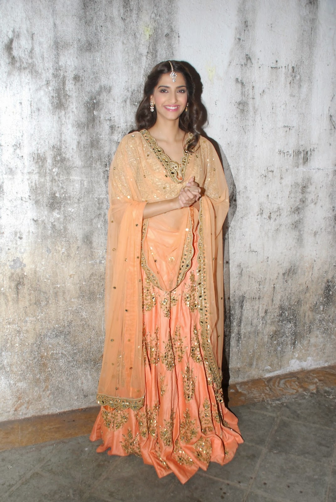 Bollywood Hot Actress Sonam Kapoor Long Hair In Transparent Orange Ghagra Choli
