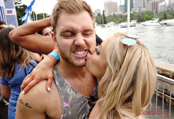 A kiss for my boyfriend for the camera.Harbour Life Music Festival Sydney 2016. Photographed by Kent Johnson for Street Fashion Sydney.