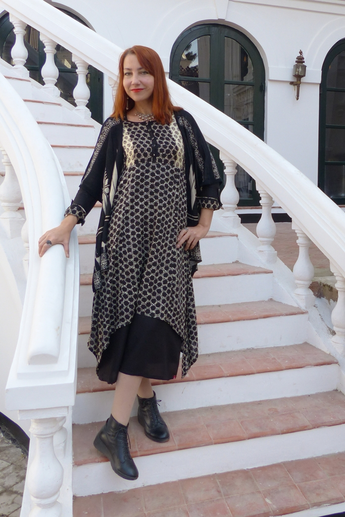 Poncho over a long layered polka dot dress