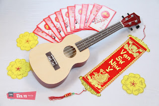Ukulele concert gỗ