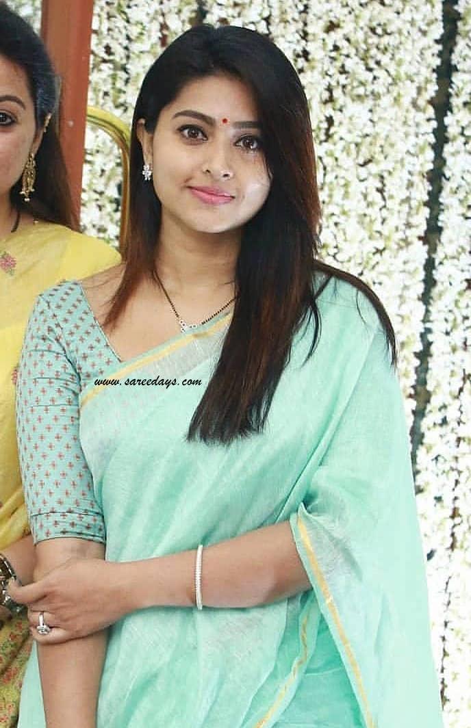 Latest saree designs sneha in green lenin saree checkout sneha in green lenin saree paired with half sleeves designer blouse altavistaventures Image collections