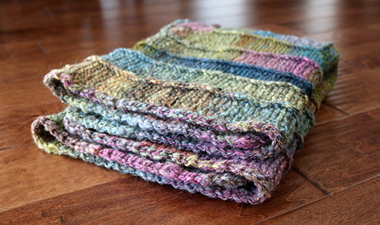 Crocheted Edging on Folded Colorful Ten Stitch Wool Knit Rug