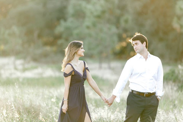 enagaged couple in field