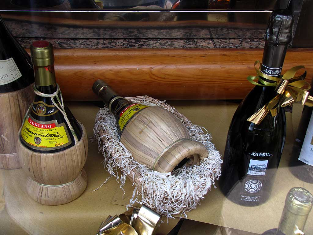 Flasks and bottles of wine in a window, via Buontalenti, Livorno