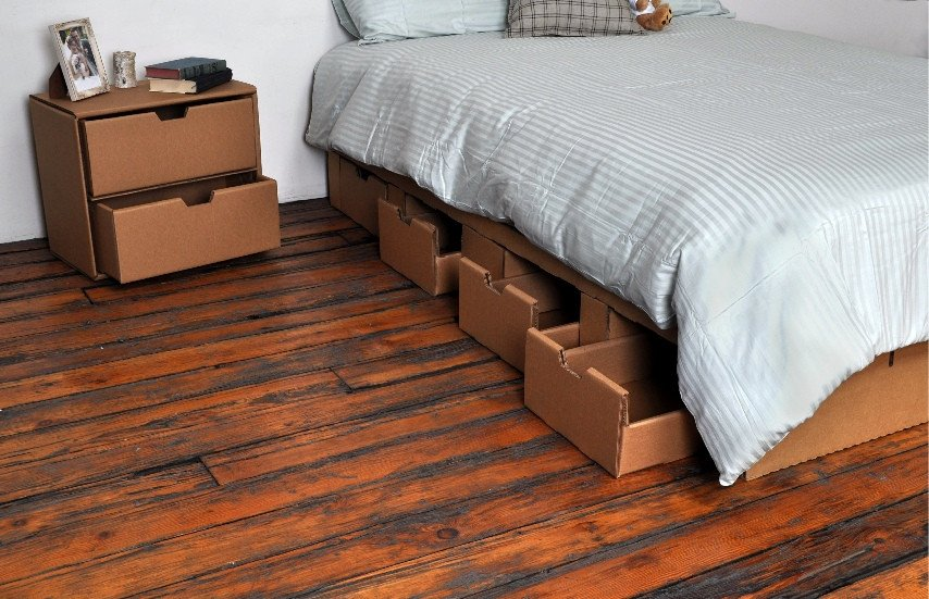 Epic The cardboard platform raises inches off the ground add a mattress and it us just high enough for you to sit on the side of the bed and put your feet