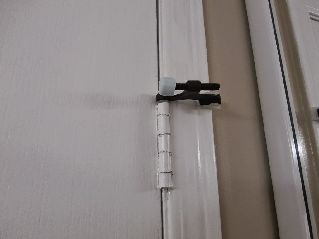The Hinge We Installed To Protect Our Mirrored Closet Doors