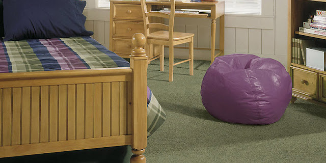 Child bedroom with green soft carpet