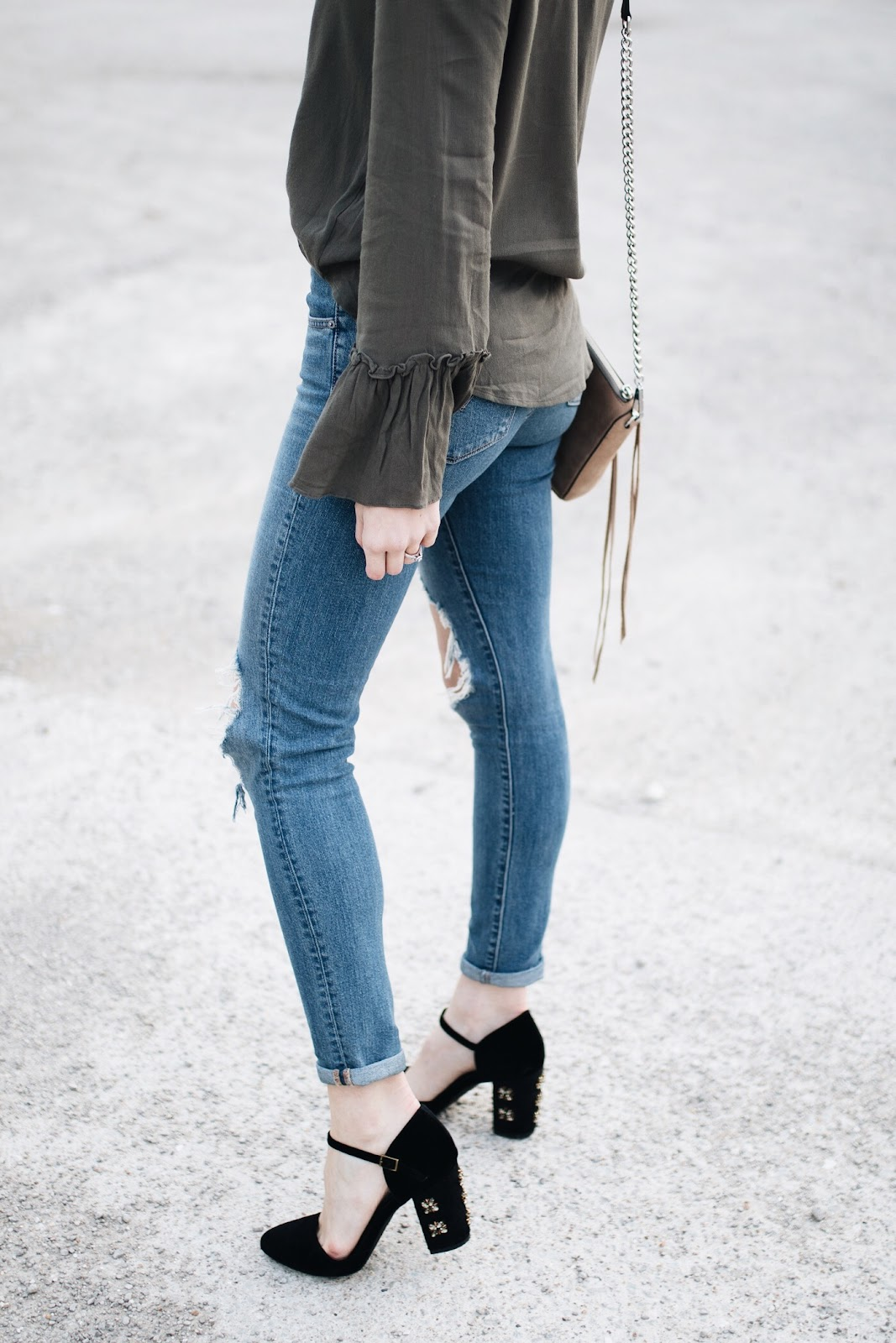 ripped jeans with velvet heels