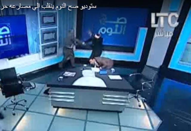 Mufti beatin live on TV with shoe over women head scarf dedabe