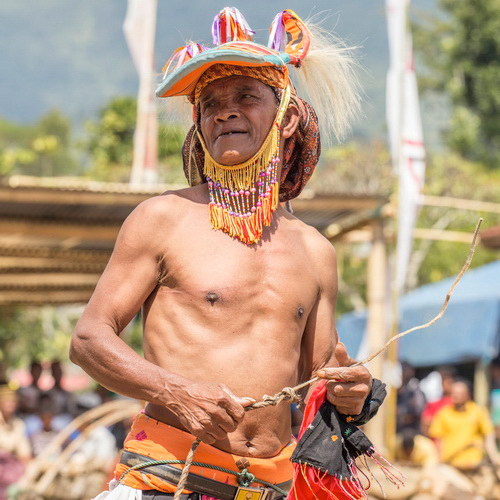 Tinuku Travel Caci is one on one fighting dance used whip and shield as harvest thanksgiving in Manggarai, Flores island