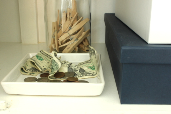 Use a tray in your organized laundry room cabinets to hold loose change