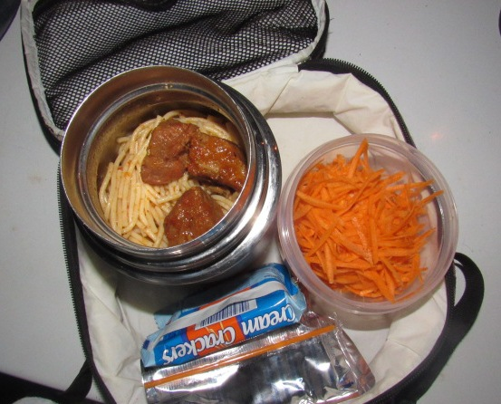 Spaghetti with stewed meats and grated carrot