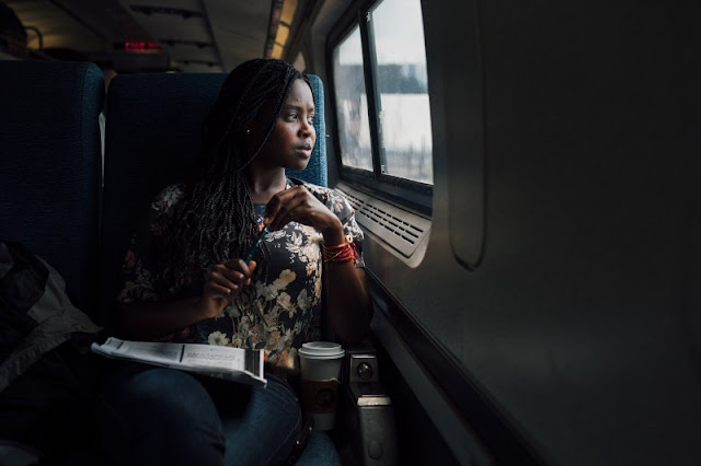 African woman in a plane