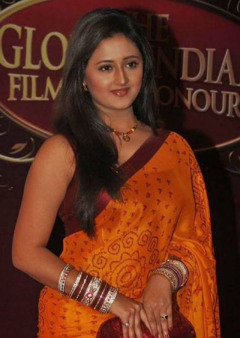 TV Actress Rashmi Desai Hip Navel In Yellow Saree