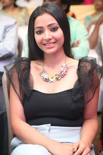 Swetha Basu in a Black Sleeveless Top Long Skirt at Mixture Potlam Movie Audio Launch 070.JPG