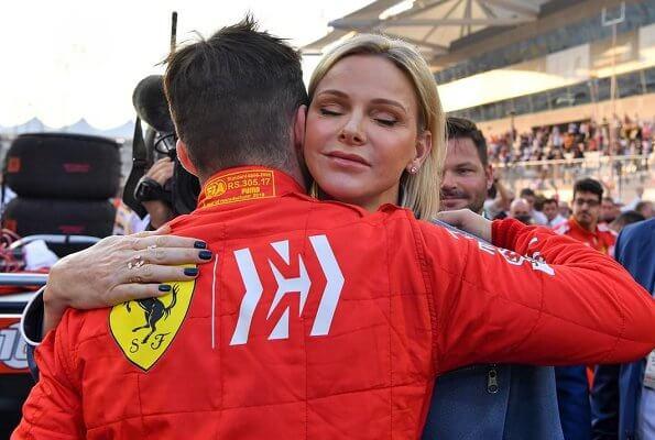 Princess Charlene visited Abu Dhabi to support Ferrari's Monegasque driver Charles Leclerc. blue jumpsuit