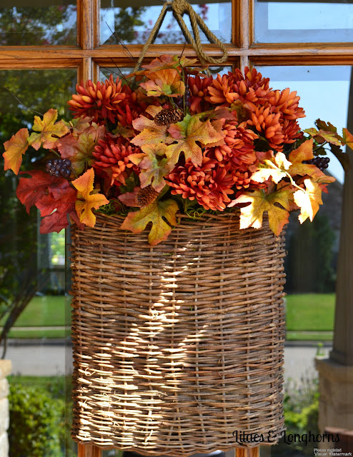 faux fall flowers in a hanging door basket