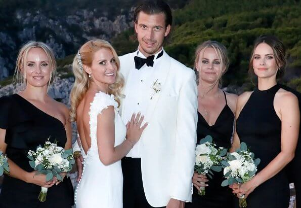 The wedding took place on Capri island. Prince Alexander and Gabriel. Carolina Pihl is the godparent. wedding dress