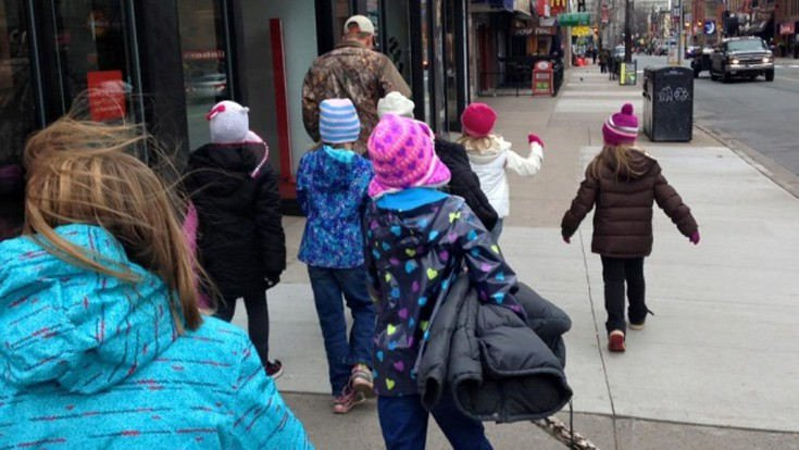 Canadian Children Wrap Street Poles With Coats So That Homeless People Can Stay Warm