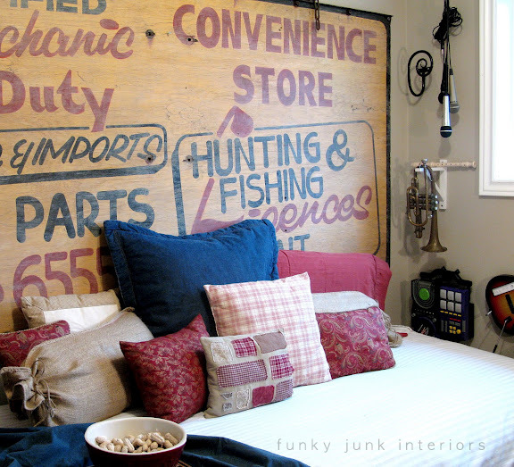 Old sign headboard in a playroom | funkyjunkinteriors.net