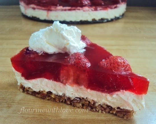 A lower carb, sugar-free strawberry jello dessert with real whipped cream!