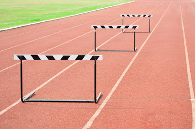 3 hurdles are set on a race track