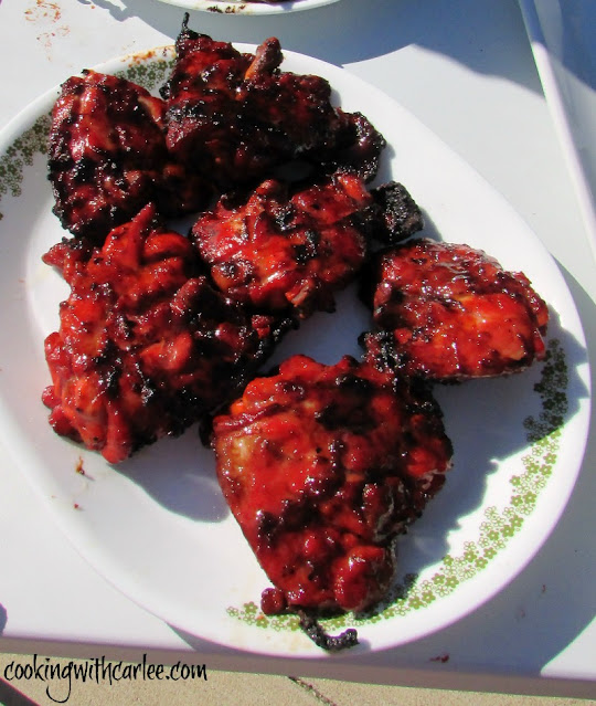 bright red grilled chicken on small platter