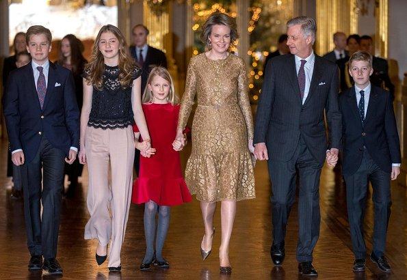 Crown Princess Elisabeth wore Zara fringed coat, Maje Poplin Shirt Dress, Diane von Furstenberg wide leg floral trousers, Maje Raphael dress