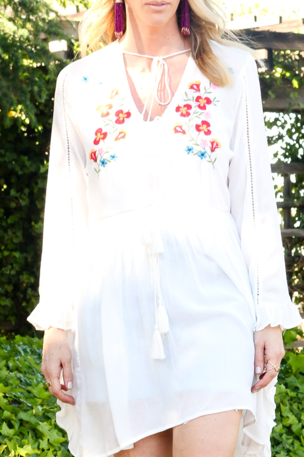 white embroidered dress with tassels