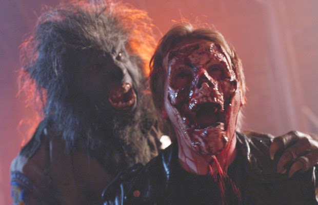 Wolfcop rips off the face of a drug dealer scaring everyone else with the bloody mess.