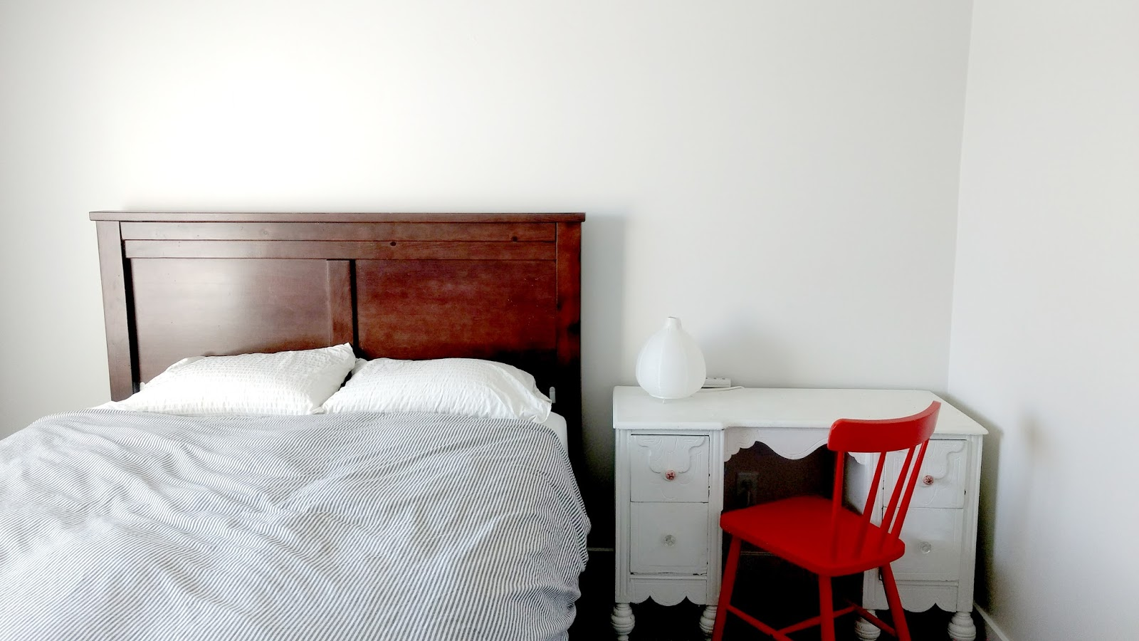Our old queen headboard and bed along