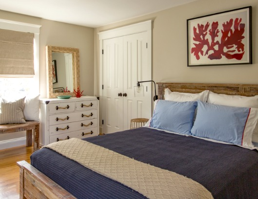 Elegant Nautical Bedroom with Red Decor Accents