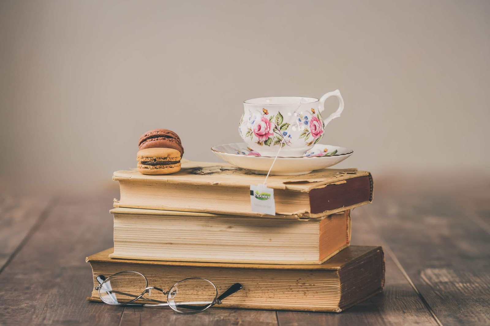 three adult ballet books macarons glasses teacup