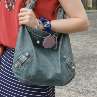 silk scarf tied in bow around wrist as bracelet and Balenciaga tempete day bag | awayfromtheblue