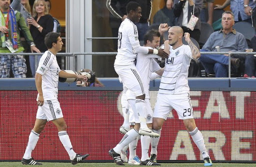Vancouver Whitecaps striker Eric Hassli celebrates after scoring against Seattle Sounders