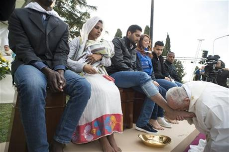 Picture of Pope Francis kissing the feet of a man at the Holy Thursday rite, held at the Castelnuovo di Porto refugee centre in Italy, March 24, 2016, where he washed and kissed the feet of 12 people including Muslims, Hindus and Christians. Photo by AP